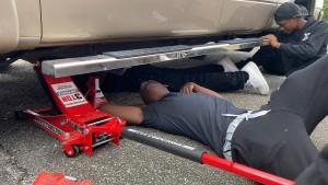 Boys Under Cars